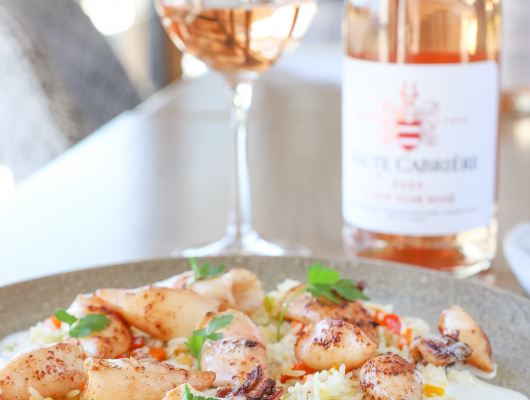 Calamari with savoury rice paired with Haute Cabrière Pinot Noir Rosé